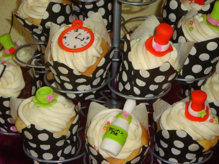 Cupcakes with sugar paste Mad Hatter Hats, Tea cups, Drink Me bottles and Pocket Watch
